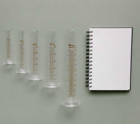Notebook and Graduated Vials by Tara Winstead