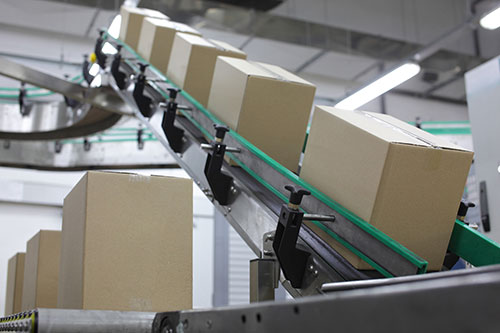 Packages on conveyorbelt, ready for shipping
